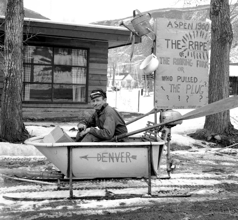 The incomparable Freddie Fisher and his float in the 1954 Winterskol parade. The sign says: Aspen 1960, the rape of the Roaring Fork, or, who pulled the plug?