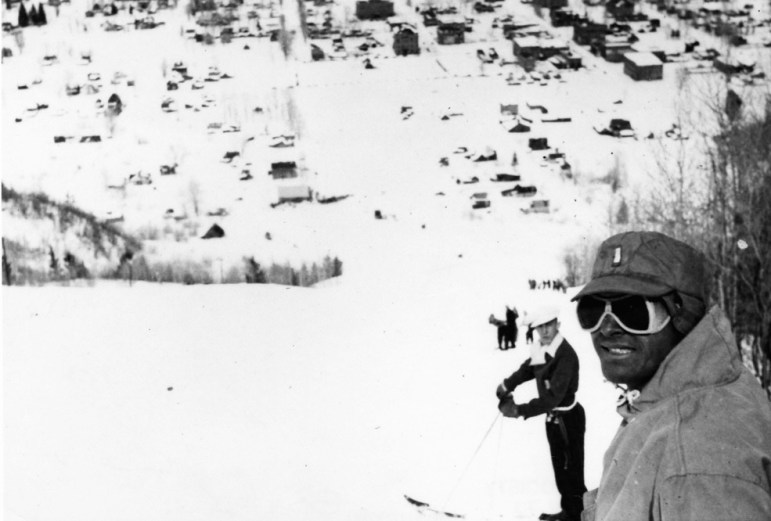 The bottom of Roch Run in 1947, which ended at the top of Monarch Street. Two skiers pose for the photo. The south end of town is visible, including the downtown core. The one in the cap and goggles is Lt. Bill Bowerman, probably of the 10th Mountain Division.
