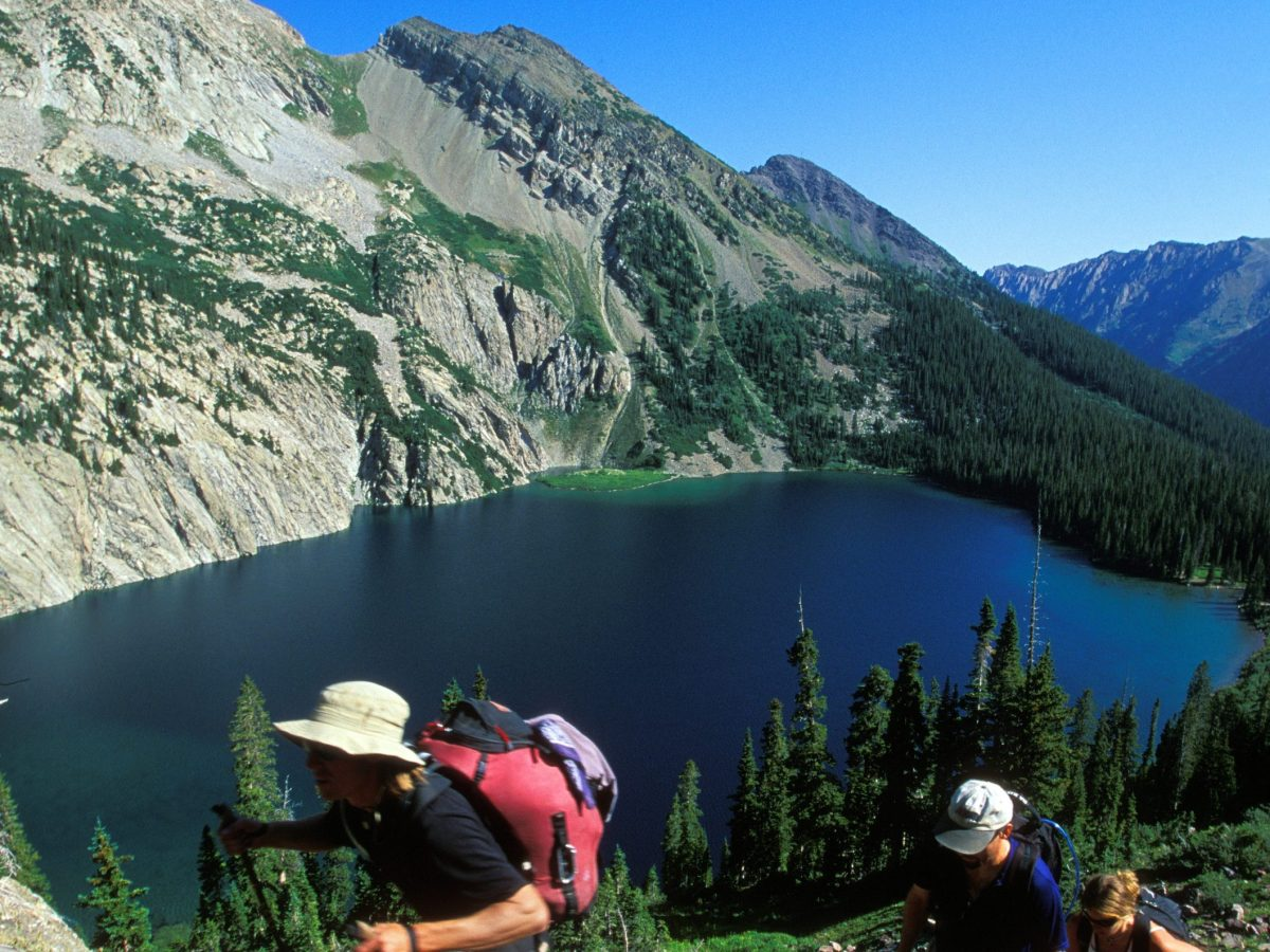 Hikers in the Maroon Bells-Snowmass Wilderness climb toward Trail Rider Pass from Snowmass Lake, below.