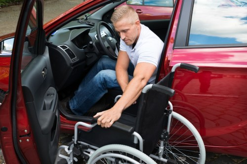 handicapped man in car with wheelchair