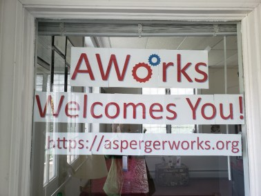 """Welcome sign on office window: """"AWorks Welcomes You"""" with URL"""