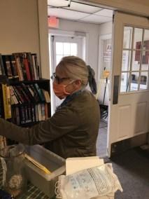 Jean Sanders perusing the church's books