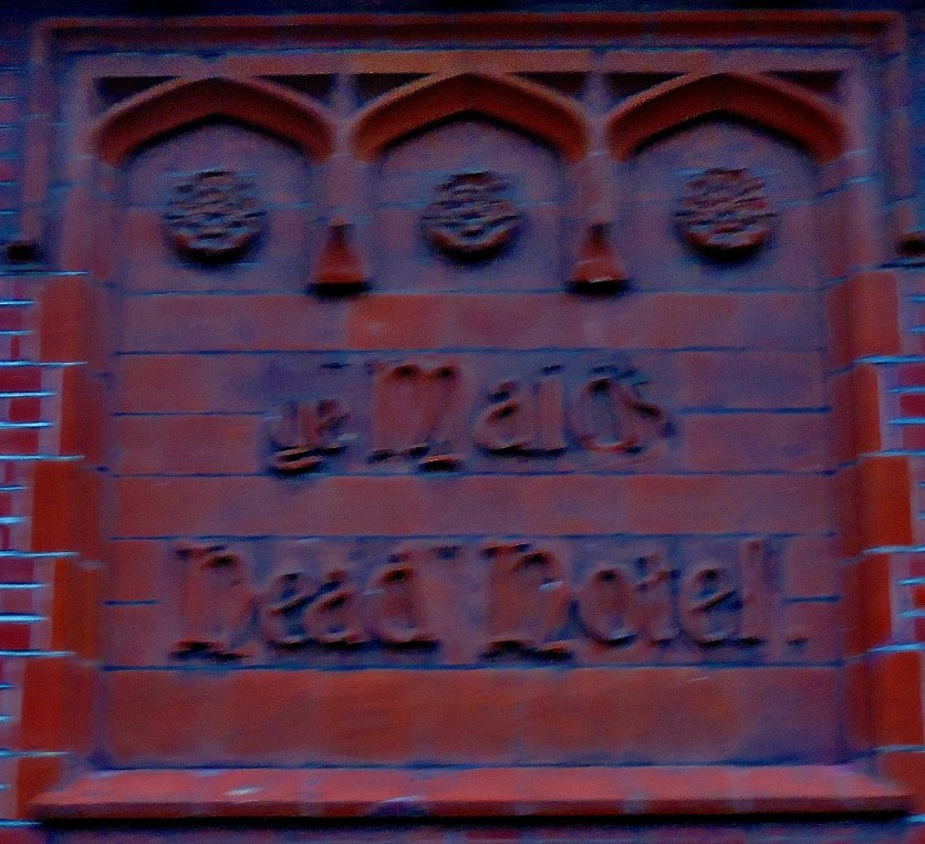 The Maids Head has a very old name sign worked into the building itself