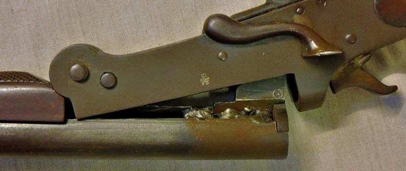 This image shows that this gun has been deactivated - it is a pure museum piece (lot 163)