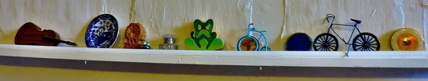 A display on a small ledge above the stairs.