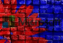 Microsoft logo painted on a brick wall