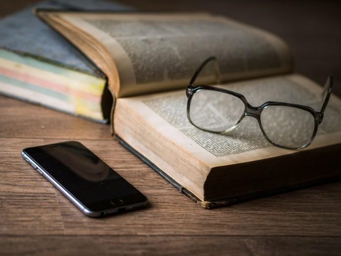 A university book, glasses, iphone