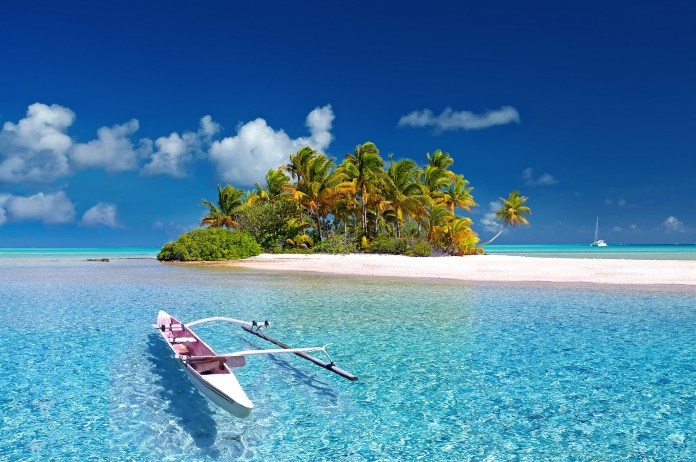 A boat floating in the clear waters of Polynesia