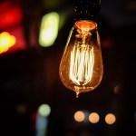 A lightbulb glowing in the night | Aspioneer