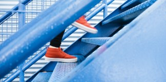 A person climbing blue stairs   Aspioneer