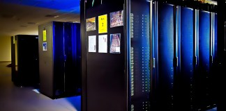 A supercomputing stack illuminated under blue light | Aspioneer