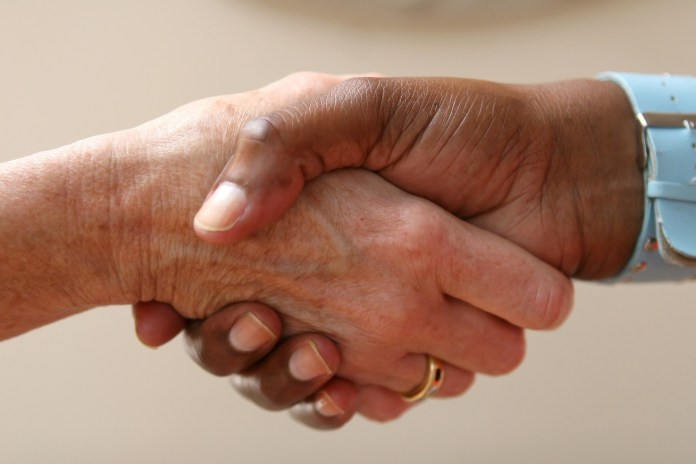 Two people shaking hands signifying negotiations | Aspioneer