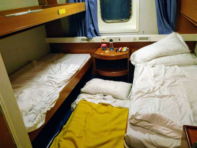 three beds in a ship cabin