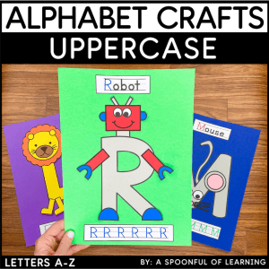 Holding the uppercase letter R craft to show an example of the completed craft.