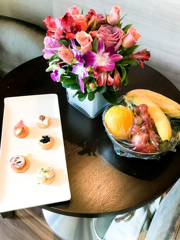 Canapes, fruit bowl and fresh flowers in Haven Spa Suite