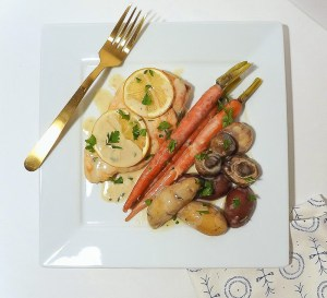 Overhead view of One Pan Chicken and Roast Veggies on a plate