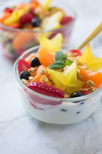 Meal Prep Fruit Salad in a bowl with yogurt and granola close up picture