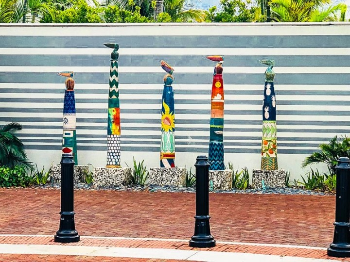Painted poles with pelicans on top