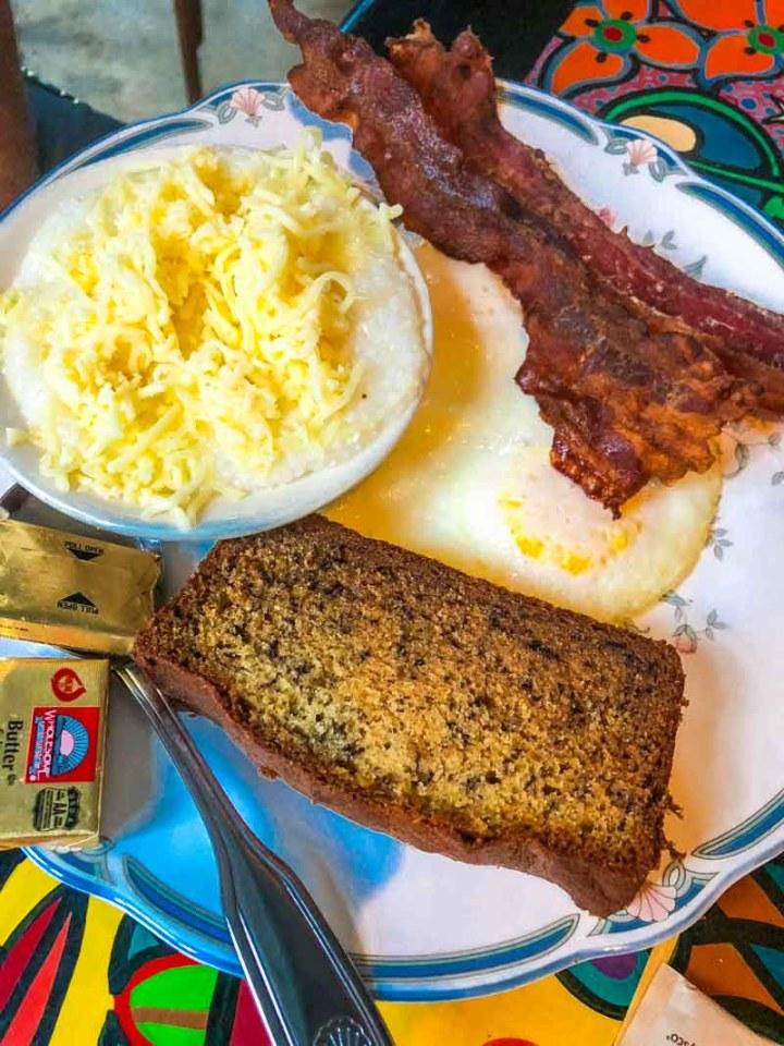 Eggs, bacon, cheesy grits and banana bread at Blue Heaven