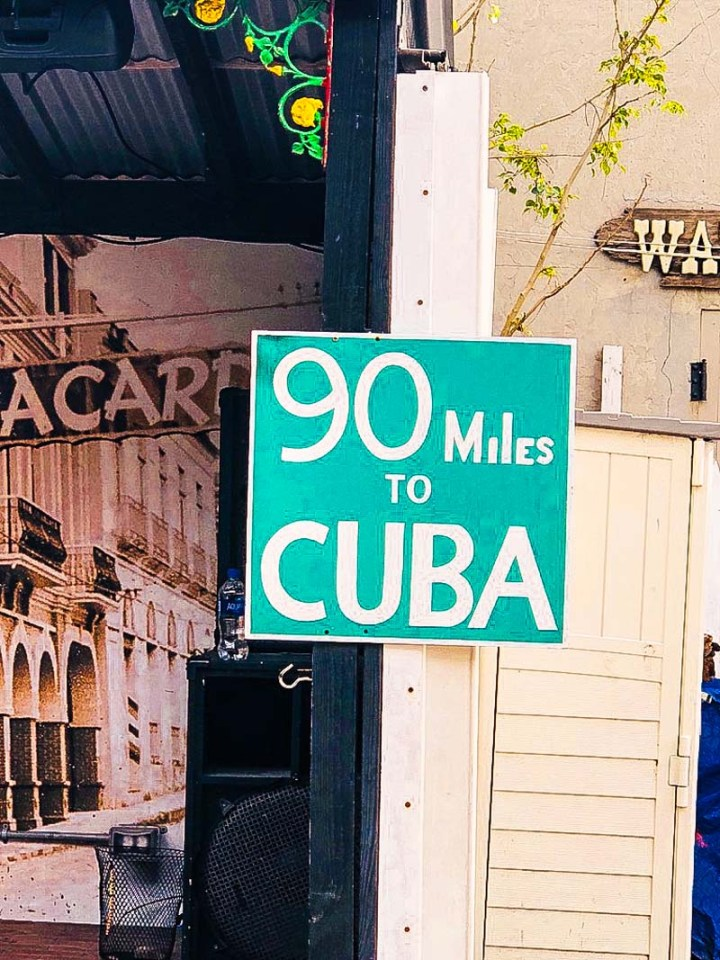 90 miles to Cuba sign on the way to the bathroom at El Meson de Pepe