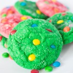 Close up of green cookie on a pile of cookies