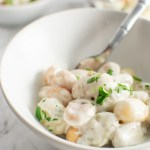 Close up of Gnocchi with Gorgonzola cream sauce in a bowl with a fork
