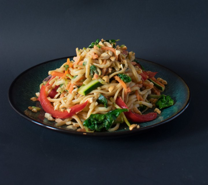 Plate of Spicy Almond Butter Vegetarian Noodles with a dark background