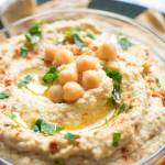 very close up view of hummus with chickpeas on top
