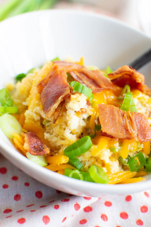 Closeup view of Loaded Baked Cauliflower Mash in serving bowl