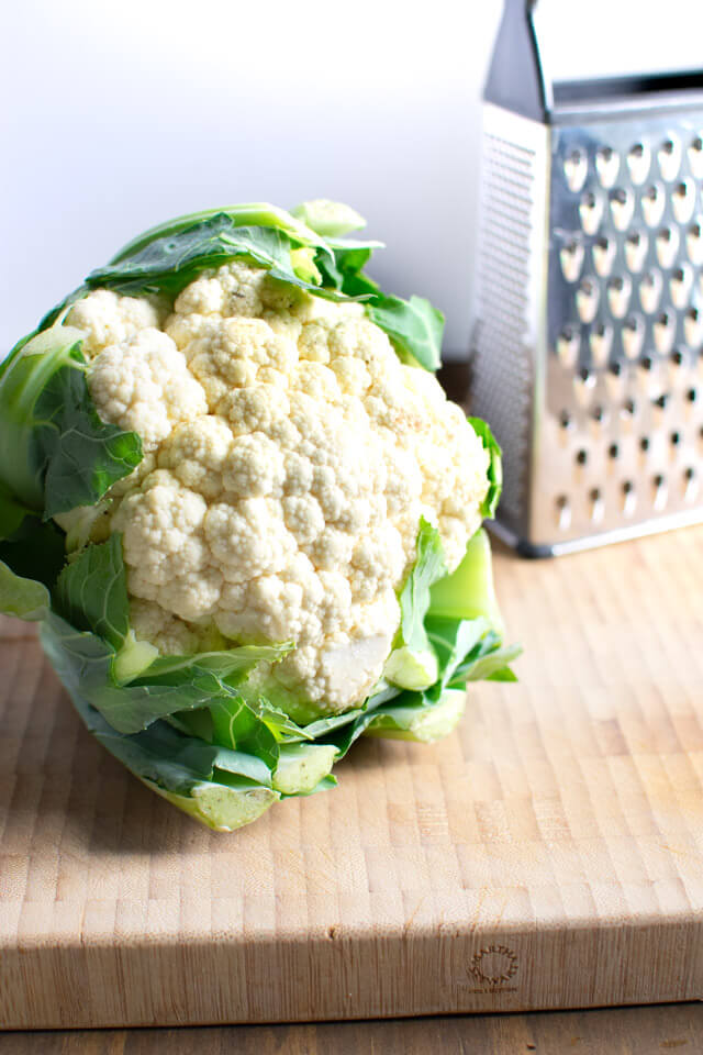 Head of cauliflower on cutting board