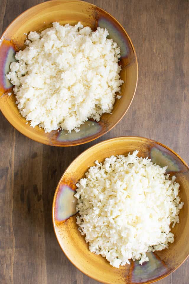 Overhead view of cauliflower rice two ways in bowls
