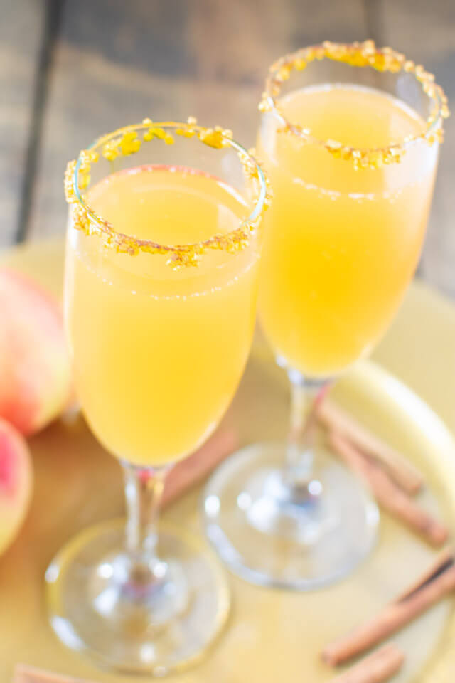 Closeup view of two apple cider mimosas
