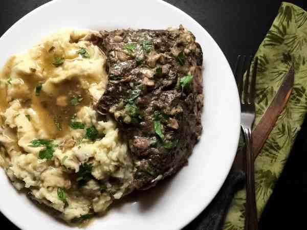 Louisiana Garlic Stuffed Beef Roast from A Sprinkling of Cayenne. | http://asprinklingofcayenne.com