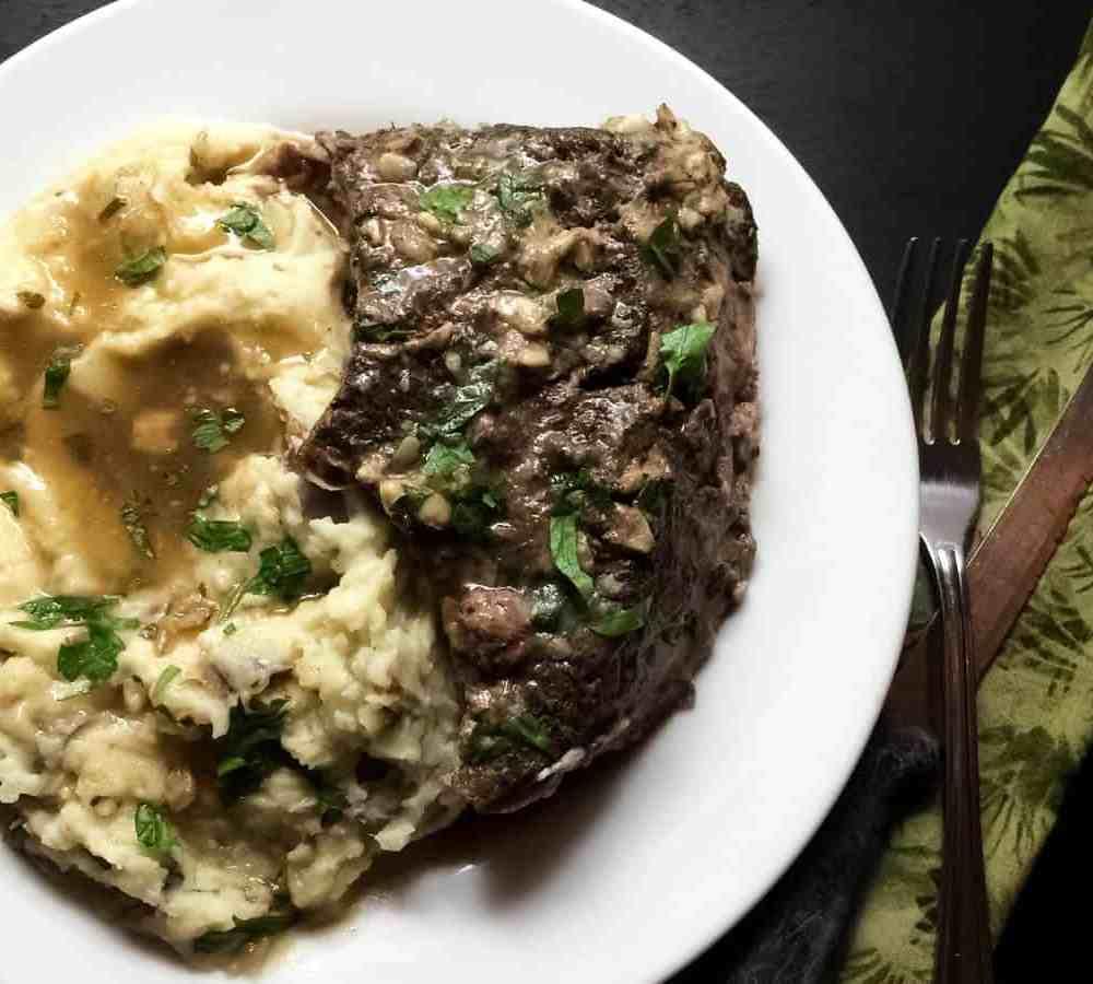 Louisiana Garlic Stuffed Beef Roast from A Sprinkling of Cayenne.   https://asprinklingofcayenne.com