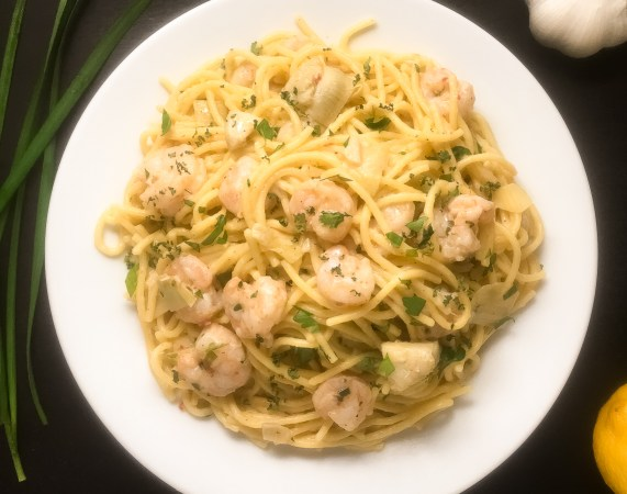 Garlic chives, lemon, and garlic help to give this gluten free shrimp scampi from A Sprinkling of Cayenne its rich, decadent flavor. | https://asprinklingofcayenne.com