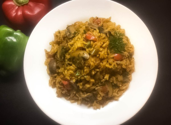 Plate of Cajun Trinity Turmeric Rice With Mushrooms from A Sprinkling of Cayenne. | http://asprinklingofcayenne.com