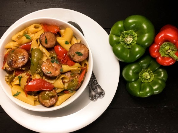 A bowl of yum-delicious Gluten Free Cajun Sausage and Peppers Pasta from A Sprinkling of Cayenne. | http://asprinklingofcayenne.com