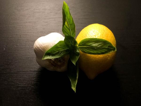 Fresh garlic, basil, and lemon for Roasted Garlic, Basil, and Lemon Spatchcock Chicken from A Sprinkling of Cayenne. | https://asprinklingofcayenne.com