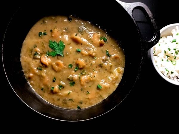 Gluten Free Cajun Shrimp Stew in a Lodge Cast Iron Pot from A Sprinkling of Cayenne food blog. | https://asprinklingofcayenne.com