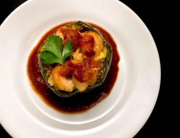 One beautiful Paleo Creole Shrimp Stuffed Pepper with Cauliflower Rice. | https://asprinklingofcayenne.com
