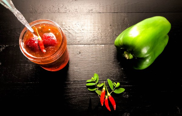 Fresh Tabasco peppers and green bell pepper for Strawberry Tabasco Pepper Jelly from A Sprinkling of Cayenne. | https://asprinklingofcayenne.com