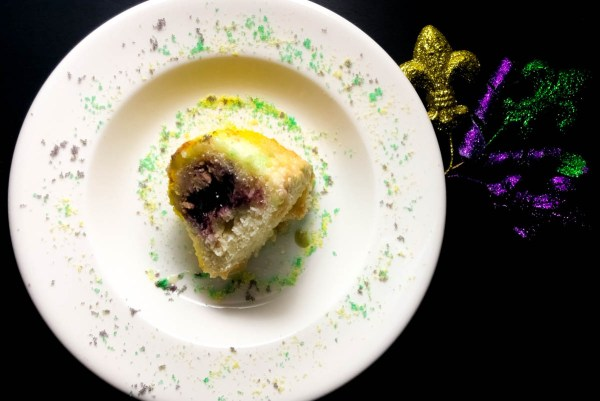 A slice of Blueberry Cream Cheese Gluten Free King Cake Bundt Cake.
