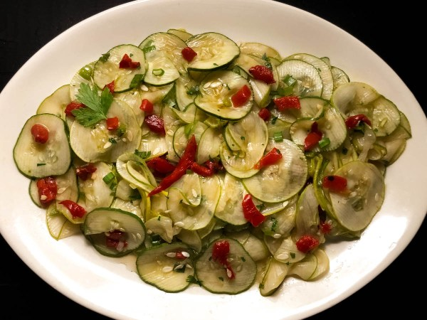 A serving plate full of Cajun Marinated Cucumber Salad. | https://asprinklingofcayenne.com