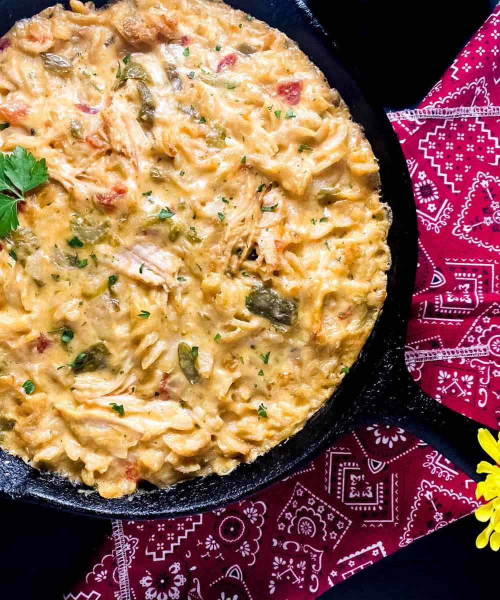A black cast iron skillet filled with Gluten Free Cheesy Creole Turkey Pasta