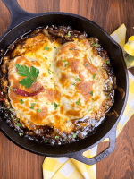 A black cast iron skillet filled with Cajun French Onion Chicken Skillet {Grain & Gluten Free}.