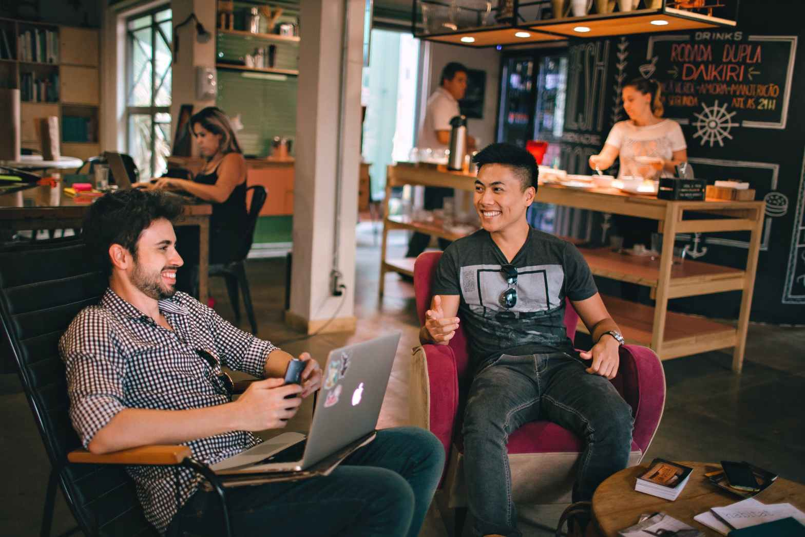 photograph of men having conversation seating on chair