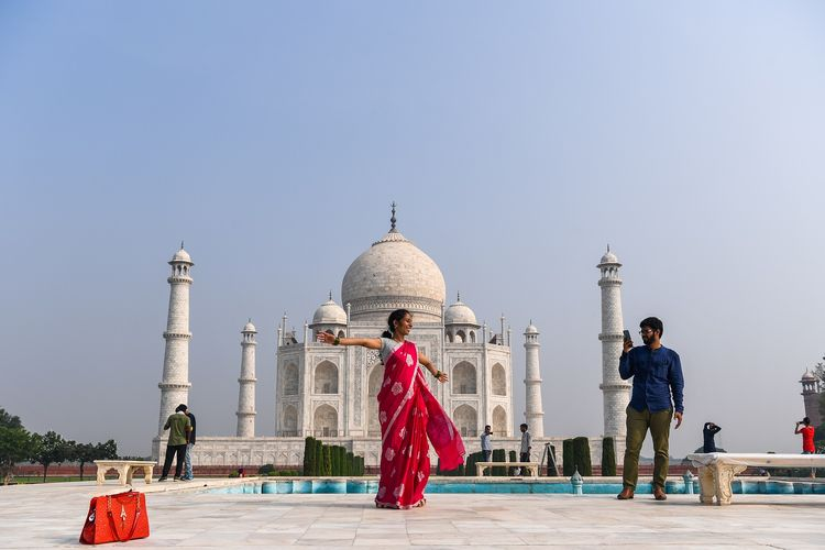Tourists visit the Taj Mahal in Agra on 21 September 2020. The Taj Mahal is reopening to visitors on 21 September in a symbolic gesture, as usual even as India looks set to overtake the US as the global leader in coronavirus infections.
