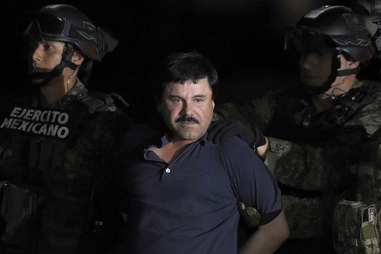 In this photo taken on January 8, 2016, drug lord Joaquin El Chapo Guzman is led to a helicopter at an airport in Mexico City after the military arrested him in Los Mochis, Sinaloa state after escaping from prison.
