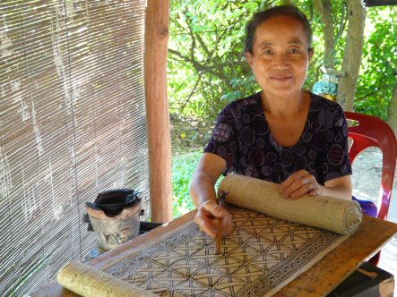 Ms Mai Suxiong, Ock Pop Tok's resident Blue Hmong batik artist