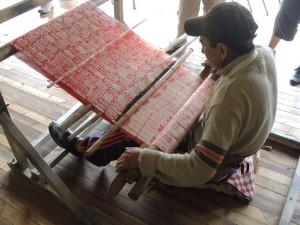 Jose Jimenez weaves a makana shawl.
